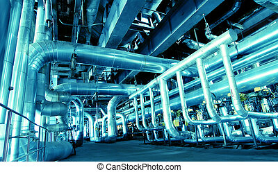 Pipes, tubes, machinery and steam turbine at a power plant...
