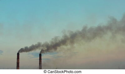 Pipes with smoke: industrial production. Thick smoke comes...