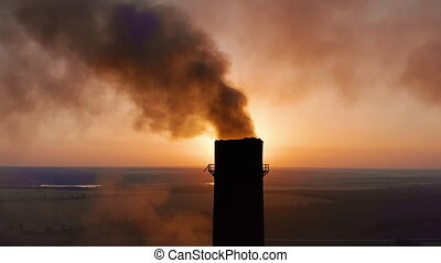 Pipes with smoke: industrial production. Thick smoke comes from industrial chemney. Concept air pollution.