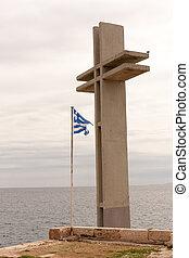 Piraeus, Greece-April 04, 2015: A huge Christian cross with the Greek flag on a port wharf