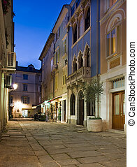 piran - old street in Slovenia coast town Piran at dusk
