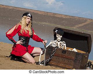 Pirate - Beautiful young female pirate in red dress.
