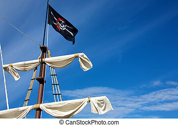 Pirate flag  - A pirate flag flying on a ships mast