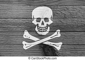 Pirate flag on a wooden plank