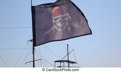 Pirate flag on the flagstaff - Against the backdrop of a...