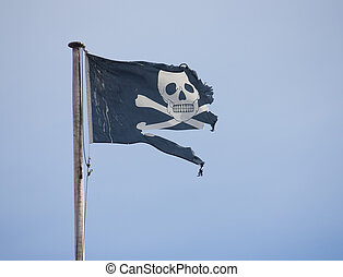 Pirate Flag - A tattered pirate flag waving in the wind.