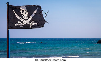 Pirate flag - A damaged pirate flag during a strong windy...