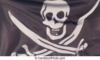 Pirate flag waving in the wind - Black pirate flag waving on...