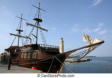 Pirate ship in harbour - A mock pirate ship, used for...