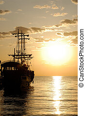 Pirate Ship - Pirates ship in the sea at sunrise