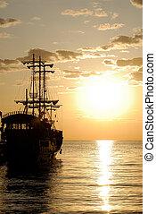Pirate Ship - Pirates ship in the sea at sunrise