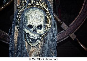 Pirate skull on ship's wheel