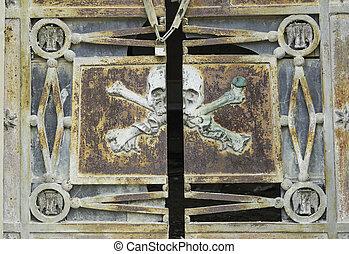 Pirate Skull rusty cemetery gate, symbol
