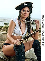 Pirate woman sitting on the beach - Beautiful pirate woman...