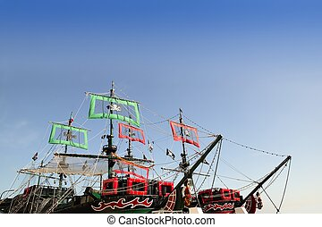 Pirates boats cut image with blue sky over