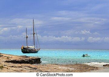 pirates inspired wood sailboat anchored turquoise sea Formentera