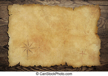 Pirates' old parchment treasure map on wood table - Pirates...