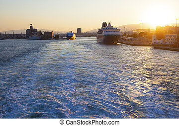 Pireus, Greece - September 15, 2019: Big ferries boats in the passenger port of Piraeus on the sunset time, Athens, Greece.