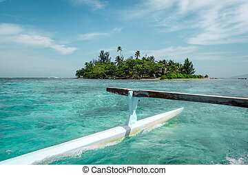 Pirogue on the way to paradise tropical atoll in Moorea Island lagoon