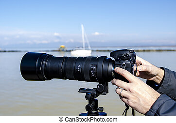 Pisa, Feb 16: Camera with Telephoto lenses, Marina di PIsa 16 February 2013. Telephoto lenses are used by photographers to capture subjects at a distance.