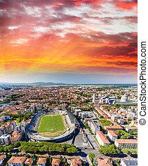 Pisa Soccer Stadium, aerial view at sunset