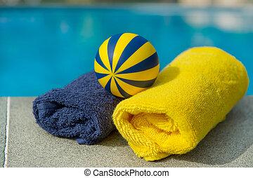 piscina, asciugamani, giocattoli