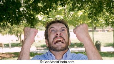 Pissed off angry furious man shaking his fists in the air -...