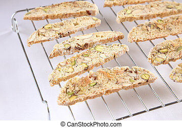 Pistachio almond biscotti thin slices on cooling rack - Food...