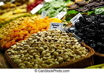 Pistachio and prunes at the La Boqueria market in Barcelona, Spain.