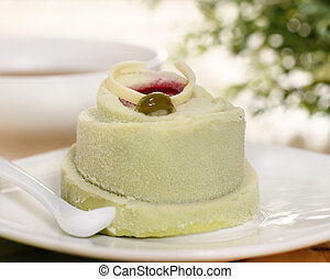 Pistachio cake decorated with a raspberry jam with coffee