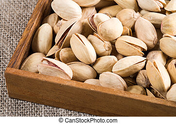 Pistachio close up in a wooden box