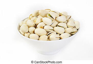 pistachio nuts in a bowl on white background