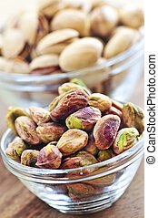 Pistachio nuts in glass bowls