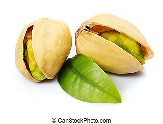 Pistachio nuts - Two pistachio nuts with leaf isolated on...