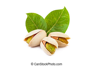 Pistachio nuts with leaves isolated on white background
