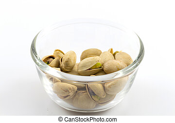 pistachios in a glass plate, isolated on white background