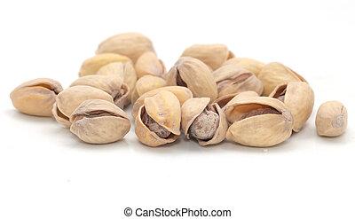 pistachios on a white background. macro