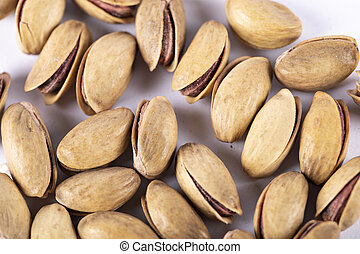 Pistachios on a white background. top view