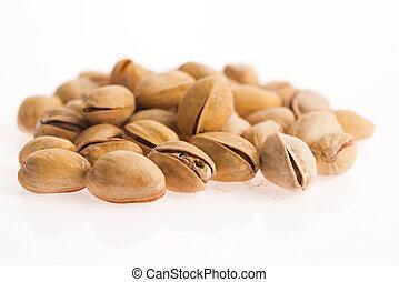 pistachios on white background