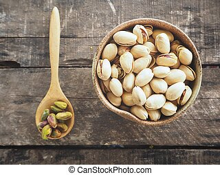 Pistachios on wood background