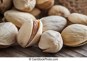 Pistachios on wooden background