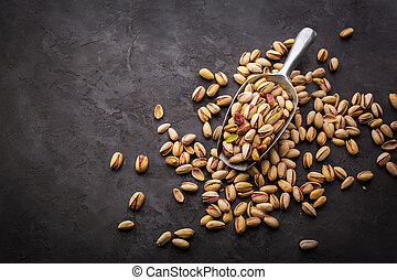 Pistachios over dark background