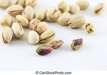 Pistachois nuts on white background.