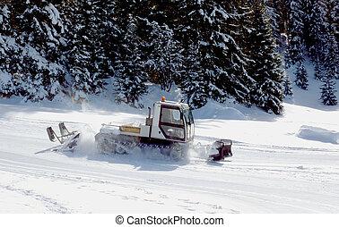 Piste basher in the mountain - Piste basher in the winter ...