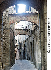 Pistoia (Tuscany, Italy): typical street in the medieval ...