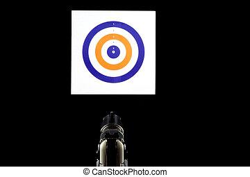 Pistol and Target at a Shooting Range