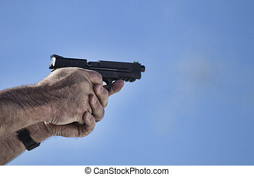 Pistol at the moment of being shot