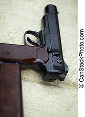 pistol (focus point on the hammer)