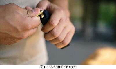 Pistol. Hands load a combat pistol to fire