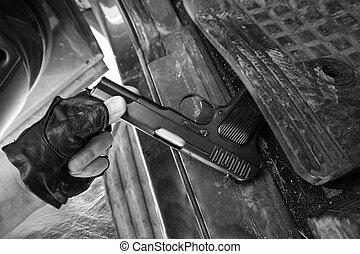 Pistol in a car